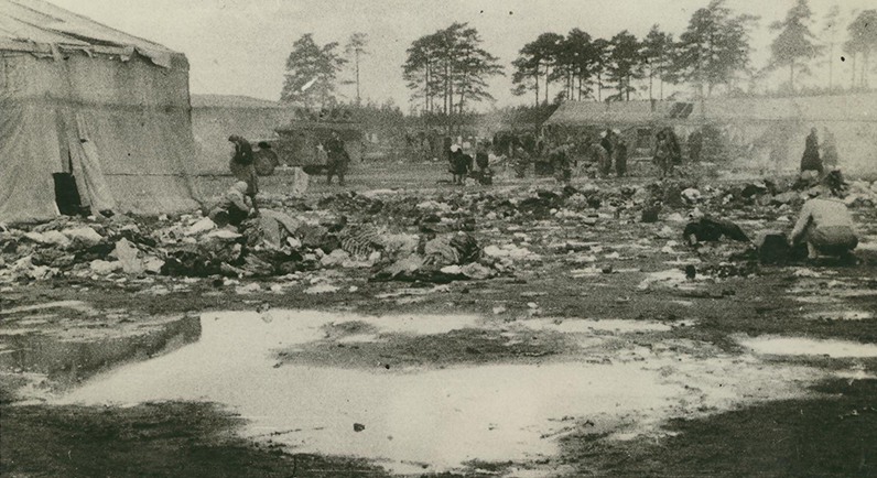 Photograph taken by Alan Moore, of survivors taking clothing from the dead. SJM Collection.