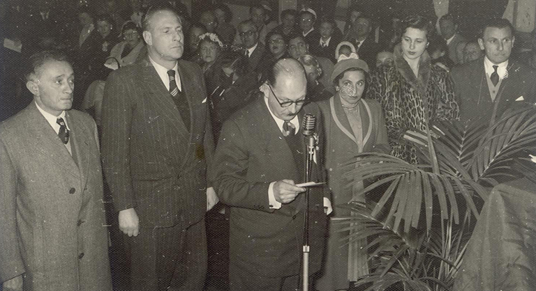 Photograph of Olga and John Horak at their naturalisation ceremony at the Bondi Beach Pavilion in 1954. Olga and John are on the far right hand side. They had arrived in Australia as refugees on 16 September 1949.