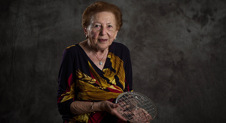 Holocaust survivor Yvonne Engelman holding a glass plate