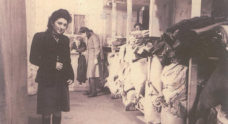 Photograph of Regina Zielinski taken in the clothing warehouse in UNRRA Displaced Persons Camp, Wtzlar, near Frankfurt, 1945